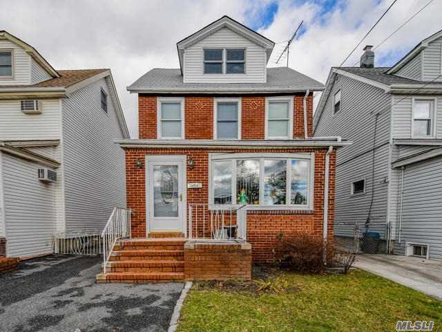 Beautiful Colonial In Desirable Bayside With Newly Renovated 1st Floor! Living Room, Dining Room, Beautiful Eat In Kitchen, Gorgeous Tile Floors Throughout First Floor, 3 Bedrooms, 1 Full Bath, Walk Up Attic, Full Unfinished Basement, 2 Car Detached Garage. Don't Miss This Fantastic Home!