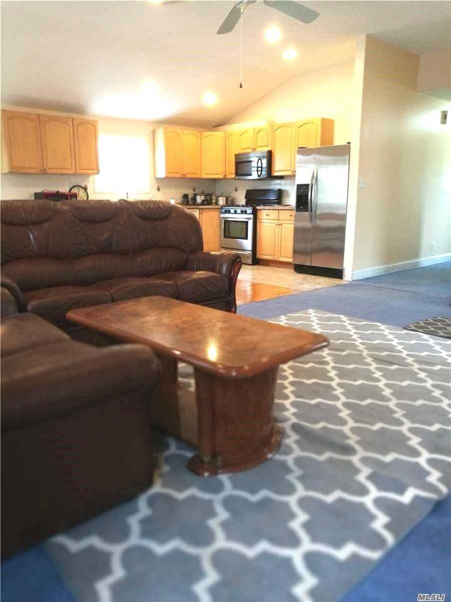 Sun-Filled, Bright And Airy Detached House/Duplex With Private Entry. Spacious 2nd Floor Apartment With 2 Balconies. 3 Spacious Bedrooms, 1.5 Bath, Kitchen, Huge Living And Dining Room Area Great For Entertaining. Convenient Location Near St. John's University And Queens College. Close To Shopping And Transportation- Bus Q65, Q34, Q25 And Qm4. Must See.