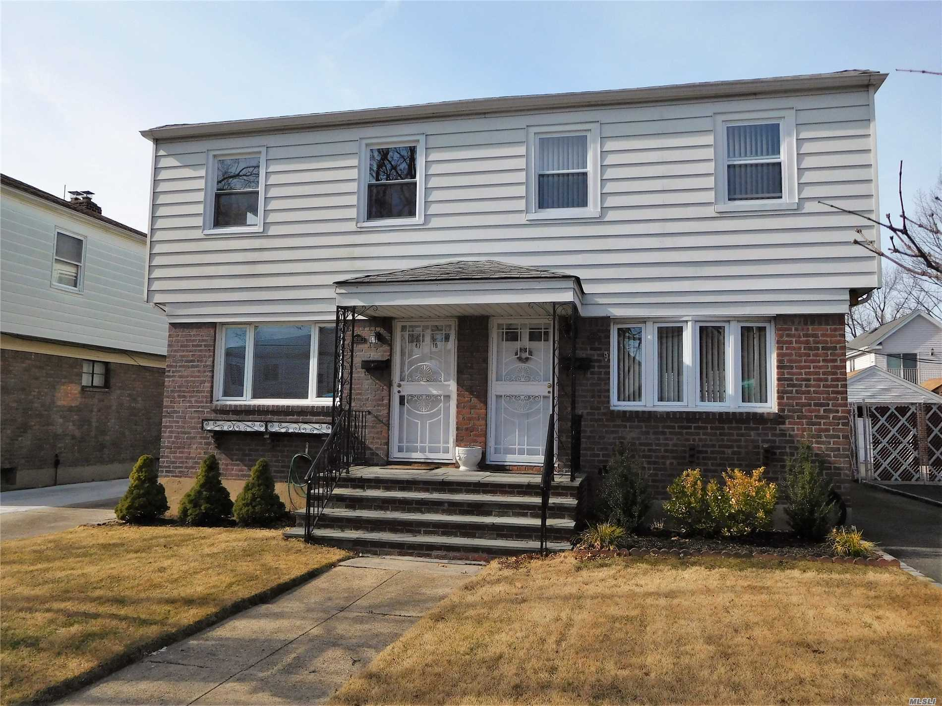 Conveniently Located. Brick And Vinyl Siding, Semi Attached 3 Bedroom Colonial. New Heating System, Central Air, Fenced Yard With Retractable Awning And An Oversized Garage With Ee. Pretty Tree Lined Street.