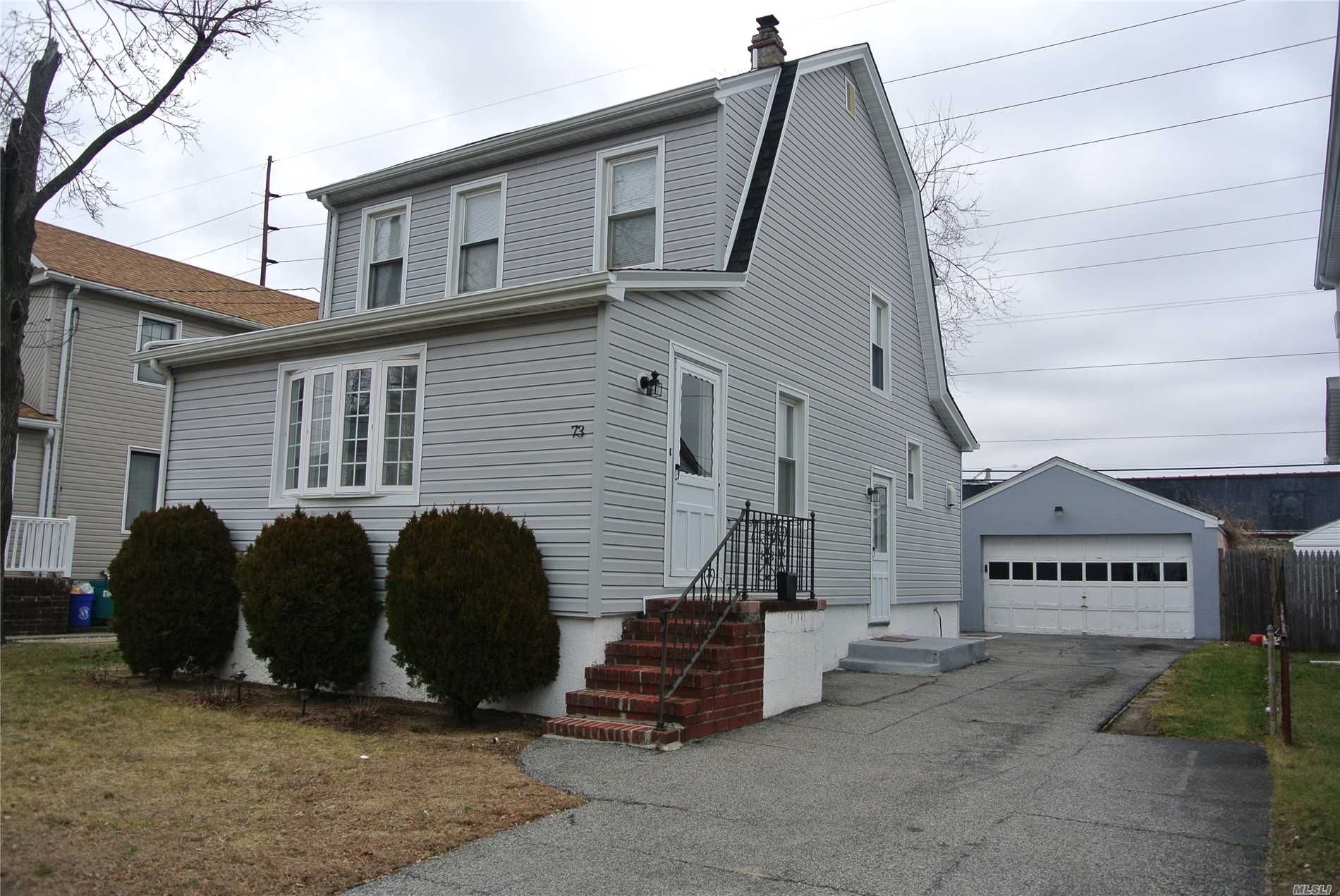 Mint Colonial, 3 Bed, 1.5 Bath, Full Basement, Close To Valley Stream Train-Station(5-10 Min Walk) Gibson Station(5-10 Min Walk) And Buses. Large 2-Car Cinder Block Garage, Many Updates Including: Roof & Siding(2013), Boiler(2012), Stove, Dishwasher, Washer, Dryer All (2016). Hardwood Floors Throughout.