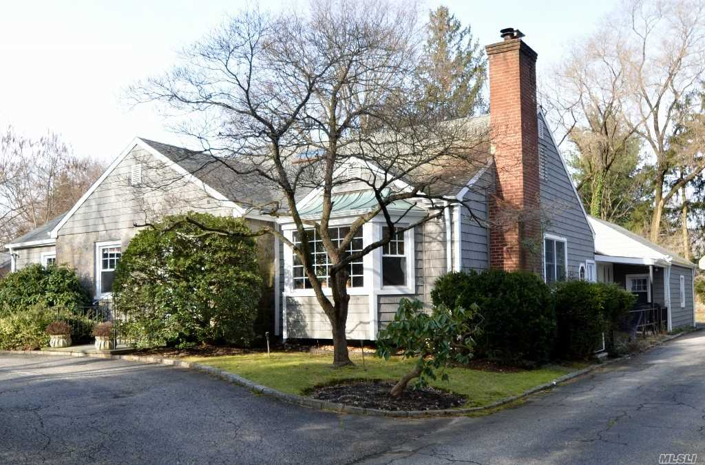 Plan Your Move For The New Year! It's A Wonderful Life Here In North Shore Acres! Enjoy Sitting By The Fireplace Watching The Seasons Change Outside Your Bay Window. Take Your Pick Of Having Your Master Bedroom Suite On The First Or Second Floor. You Will Also Appreciate The Custom Woodwork And Charm Of This Home! Award Winning North Shore Schools! A Must See!