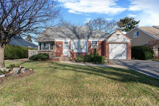 Expanded Cape Cod On Over-Sized Plot In Desirable Wantagh Woods. 4 Bedroom, Formal Dr, Sun Room And Large Living Room. 2 Ductless Ac Units. Low Taxes $10, 071. Close To Lirr