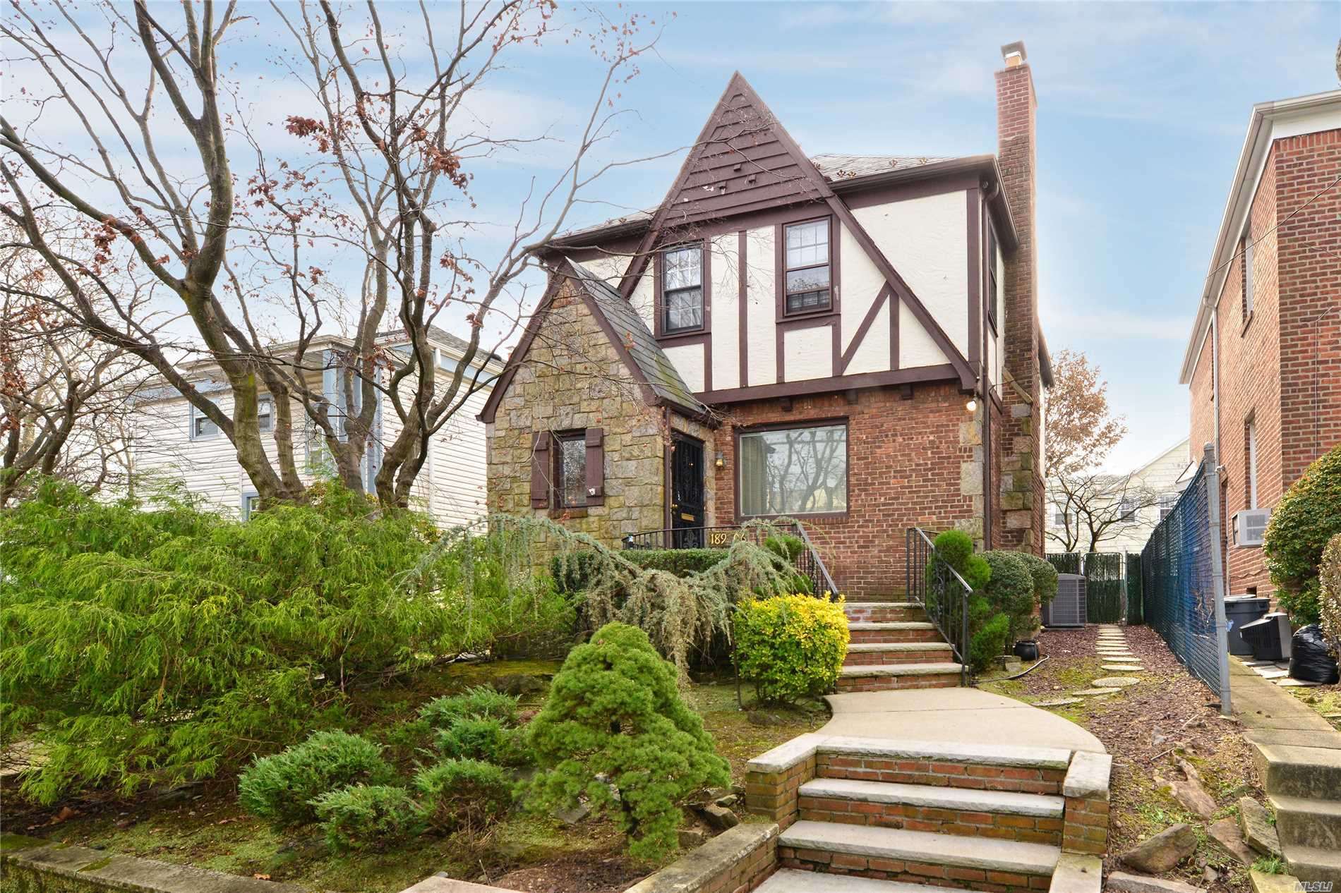 Just Listed... But Not For Long! Beautiful Detached Tudor Style Home Conveniently Located In Prime North Flushing Neighborhood. Super Convenient To Shopping & Transportation. Some Upgrades Include- Newer Kitchen & Bathroom,  H.W. Heater, Upgraded Electric, Sprinkler System, Alarm System & Waterproof Basement. School District 25 - P.S. 32,  I.S. 25,  Francis Lewis H.S.