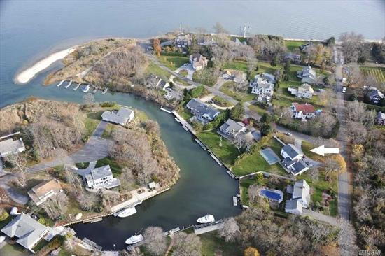 Waterfront Home In Bay Front Community. Waterside In-Ground Pool, Deep Water Dock. Wonderfully Private Yard. Association Beach. Newly Renovated And Ready To Move In. Four Bedrooms, 2.5 Bath. Great Opportunity!
