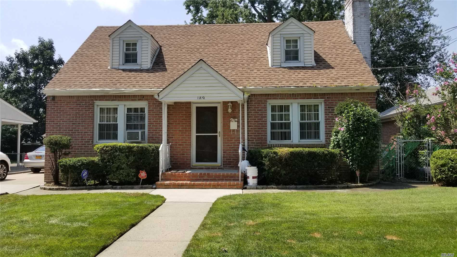 Completely Renovated And Extended Brick Wide-Line Cape. Basement And First Floor Extended. Outside Entrance To The Basement(Renovated Seven Years Ago). Near Chaminade, Hospital, Park, Library, Schools, Long Island Rail Road. Custom Granite And Stainless Steel Huge Eat-In Kitchen, Very Extended. A Must See To Appreciate.
