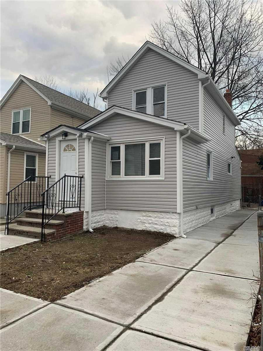 Renovated 1 Family Home In Laurelton With Private Drivway, 3 Bedrooms, 3 Full Baths, Full Finished Basement With Separate Entrance, Hardwood Floors, New Appliances, Camera System, New Water Pipe Line From The Street.