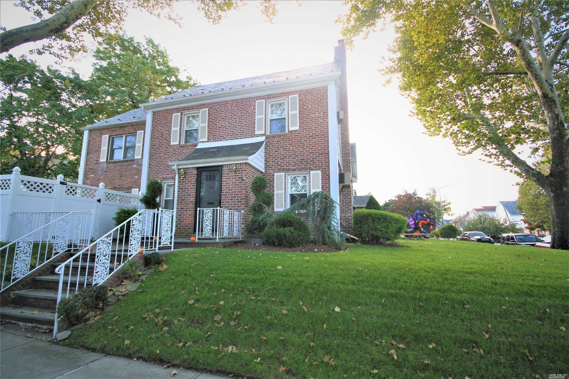 Detached And Expanded Brick Colonial On A Bayside Hills Corner Property; Featuring An Ensuite Master Bedroom, Living Room With Fireplace, Finished Basement, H/W Floors And An Eat-In Kitchen That Opens To A Family Room With Sliding Doors To A Private Patio And Hot Tub. Lots Of Improvements Including New 3-Zone Gas Heat And In-Ground Lawn Sprinklers. Great Location Near Mass Transit (Q27 And Q31 Buses) And Schools (Ps 203 And Ms 158).