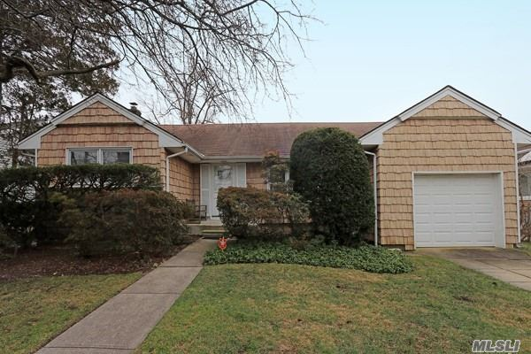 Start The New Year Right With This 3 Br, 1.5 Bathroom, Center Hall Ranch, Set On Oversized 75X104 Property. Lr, Eik With Door To Yard And Patio, Large Formal Dining Room, Whole House Attic Fan, Alarm, Hw Floors In Foyer, Bedrooms And Under Carpets In Living Room. Huge Basement Perfect Mancave Or Playroom! Lovely Midblock Location - Low Taxes - A++ Schools. Sold As Is