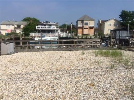 Recreational Waterfront Property For Sale. 40X32 Lot. Newer Bulkhead, 4 Boat Slips, Water & Electric On Site, Brand New White Gravel, New Fencing, Low Taxes. Boater's Delight! Deep Water And Wide Canal On Reed Channel. Looking For A Place To Dock Your Boat(S)? Here It Is! Minutes To Open Bay. Great Location! Fisherman's Delight!