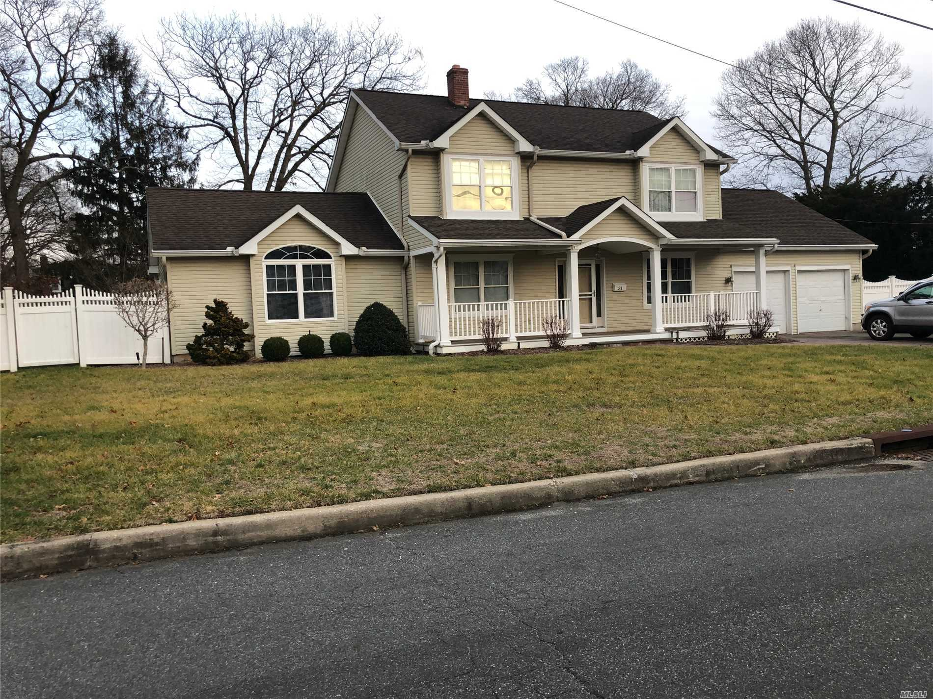 Beautiful Kings Park Colonial Renovated In 2006 Features 4 Bedrooms, 2 Bathrooms, Formal Living Room, Large Great Room, Eat-In-Kitchen With Doors Leading To Beautiful Backyard Set On .38 Of Acre With Paver Patio, And Office. 2 Car Garage, Vinyl Siding, 2 Zone Central Air (2013), 200 Amp Electric, Inground Sprinklers, Front Porch, Unfinished Basement With Outside Entry & More. This Is A Must See!
