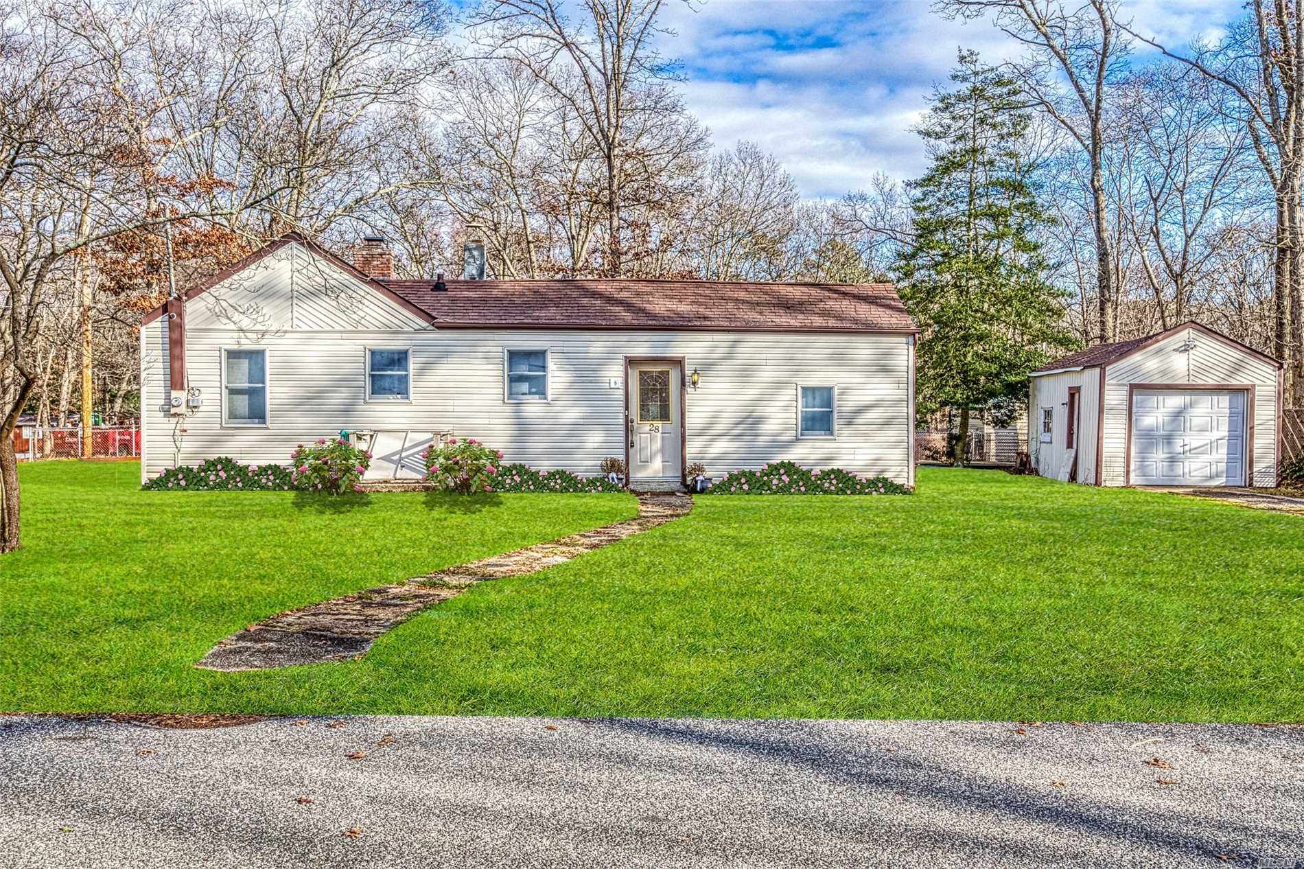 Perfect Starter Or Retirement Is This 3 Bedroom, 2 Full Bath Ranch With Endless Possibilities To Make This Your Own! Den With Brick Wall Fireplace, Vaulted Ceilings, Skylight, French Doors, & Hi Hats, Eik W/Vaulted Ceilings & Hi Hats, Hardwood Floors Throughout, All Located On .25/Acre Corner Property With Detached 1 Car Garage & Plenty Of Parking In Desired Lake Panamoka!