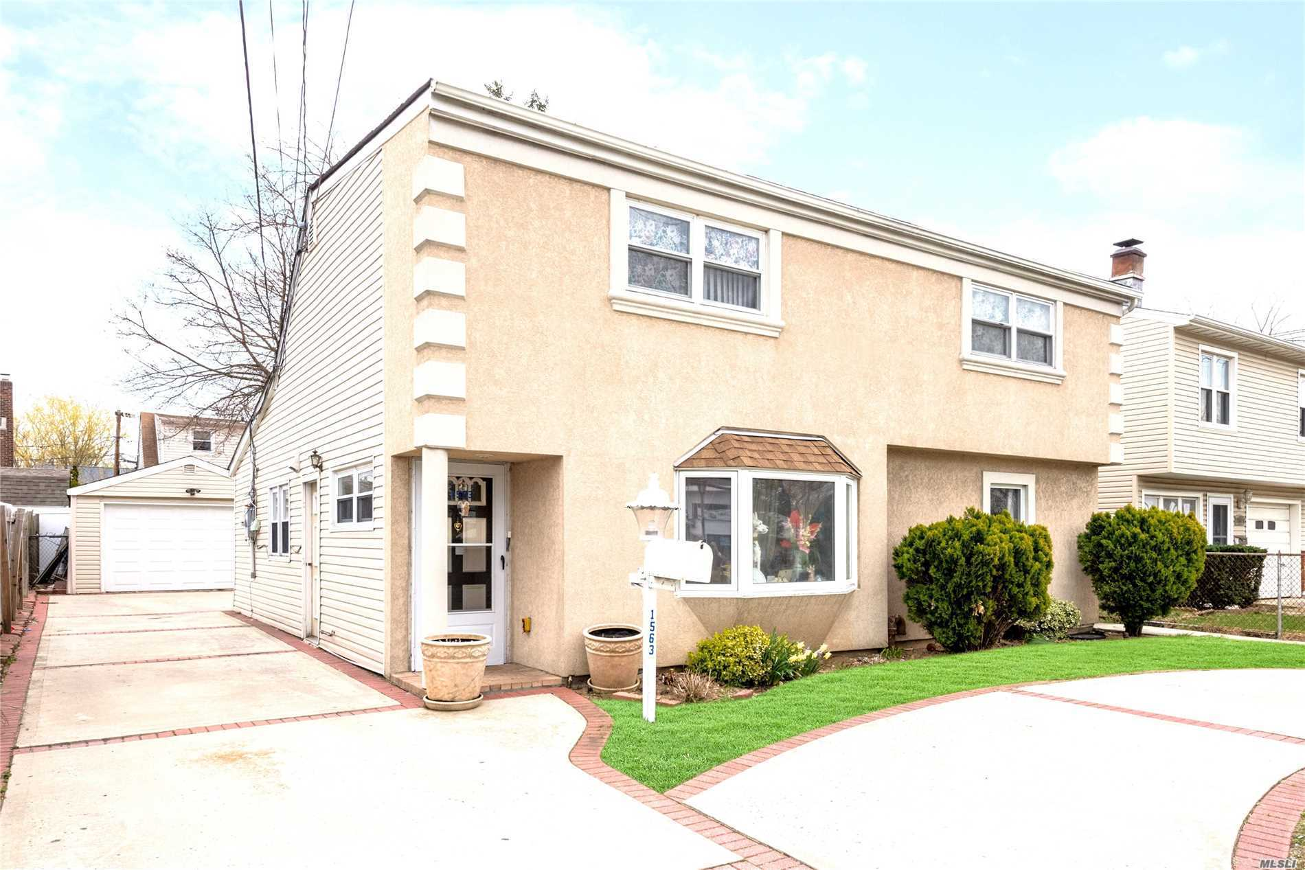 Best Priced Colonial In Merrick -- Features 5/6 Bedrooms, 3 Full Bathrooms, 2 Living Rooms, Dining Room Also Features Skylights. Ideal For Mother/Daughter, Second Floor Has A Separate Private Entrance, Spacious Driveway -- Can Be Easily Converted To A Legal Two Family Home. Taxes Are Being Grieved.