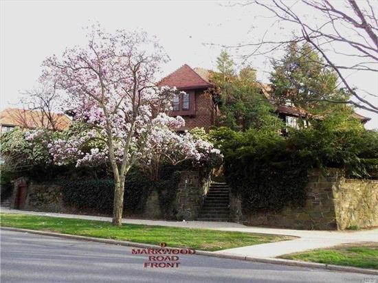 The Mansion On The Hill!! Located At The Head Of Embassy Row Atop A Classic Stone Wall, This Tree Hidden Spacious Corner Tudor Recalls The Splendor Of Early Forest Hills Gardens. Large Rooms, High Ceilings, & Hardwood Parquet Floors Provide The Potential For The Ultimatd Luxury Dream Home In This Beautiful Private Community. Detached 2 Car Garage..Close To Shopping And Subway...Must See!!!