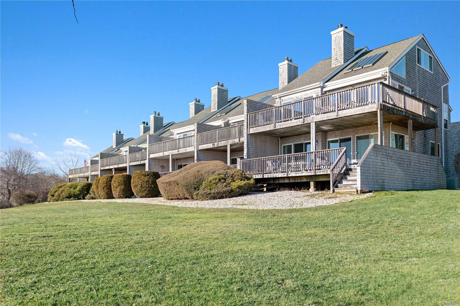 Gated Waterfront Condo Community! Enjoy Breathtaking Views Of Harts Cove And Moriches Bay From Your Private Deck. Home Features New Flooring, Upgraded Baths, 3 Bedrooms, 3 Full Baths, Large Living Room W/Fireplace And Vaulted Ceiling, Eik, Dr, And Loft Office. Community Features Pool, Tennis, And Deeded Boat Slip Which Allows You To Boat To The Beach!