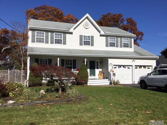 Beautiful Colonial On Quiet Street In East Islip School District With Welcoming Front Porch. This 2700+Sq Ft Home Was Built In 1995 And Has Large Eik W/Granite Counters And Slider To Big Back Yard, Most New Appliances, 200 Amp Electric, Full Basement And 2 Car Attached Garage. Plenty Of Space For Any Lifestyle!!