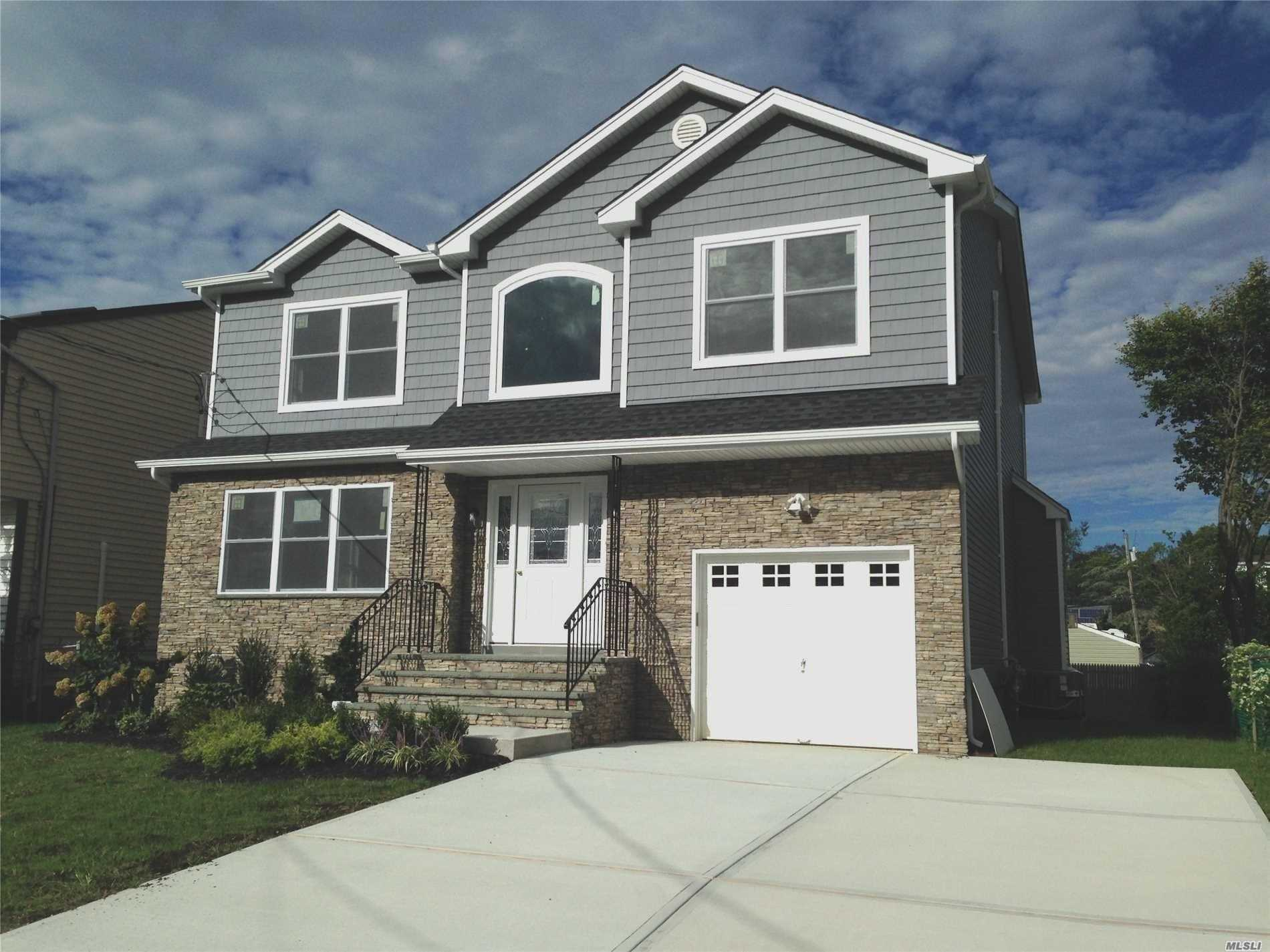 Impeccable Brand New Construction, Center Hall Colonial, 4Br, 2.5Ba, Designer Kitchen, Dbl Oven, S/S App, Quartz Counter W/Island & Microwave, Master Suite, W/Lg Shower & Jcuzzi Tub, 2 Wic, Gleaming H/W Floors Throughout, Crown Molding, Family Room W/Gas Fplc, Attic, Auto Garage Door, Alarm, Close To All, Li Rr. Quiet Block......
