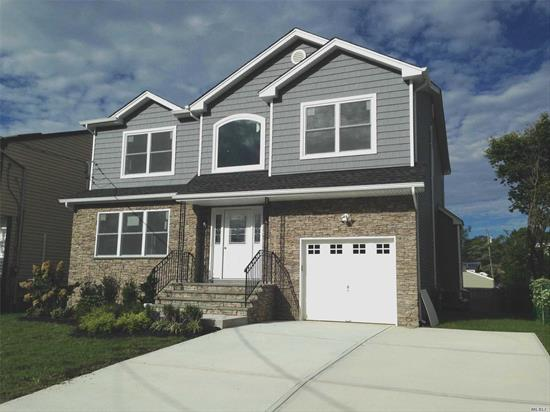 Impeccable Brand New Construction, Center Hall Colonial, 4Br, 2.5Ba, Designer Kitchen, Dbl Oven, S/S App, Quartz Counter W/Island & Microwave, Master Suite, W/Lg Shower & Jcuzzi Tub, 2 Wic, Gleaming H/W Floors Throughout, Crown Molding, Family Room W/Gas Fplc, Attic, Auto Garage Door, Alarm, Close To All, Li Rr. Quiet Block..............