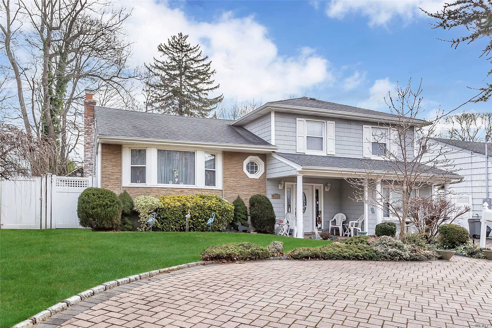 Large Updated Split In Desirable Wantagh Woods Section, Conveniently Located Close To Major Highways, Shopping, Schools, Places Of Worship And The Lirr. Beautiful Pavers, Circular Driveway, Gleaming Hardwood Floors, Marble Entryway, Full Finished Basement, Updated Siding, Kitchen And Three Full Bathrooms.
