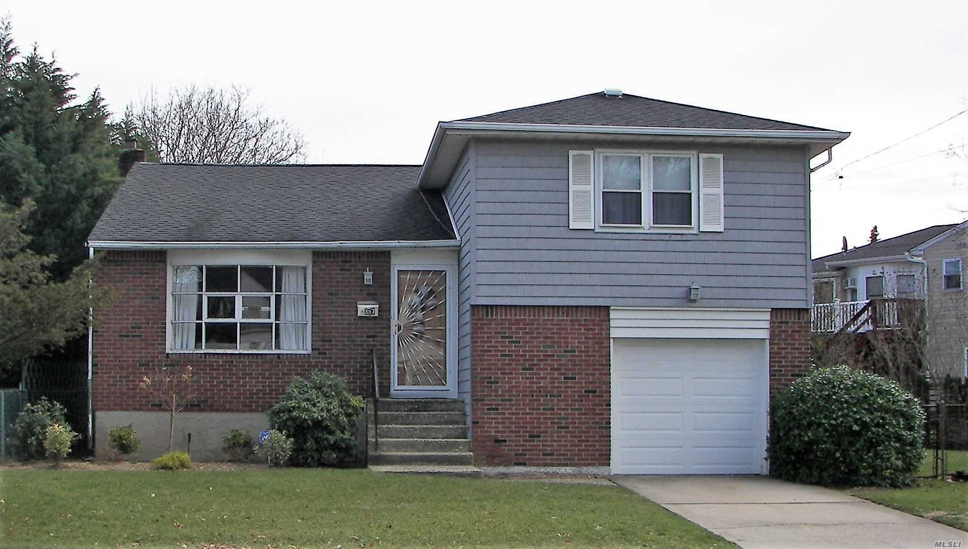 Super clean split level home, featuring wood floors, 3drms/2bths, heated sunroom, large yard & 1 car attached garage. This split has 3 levels, the unfinished basement providing more living space potential. Close to all transportation & shopping. Prime North Baldwin location.
