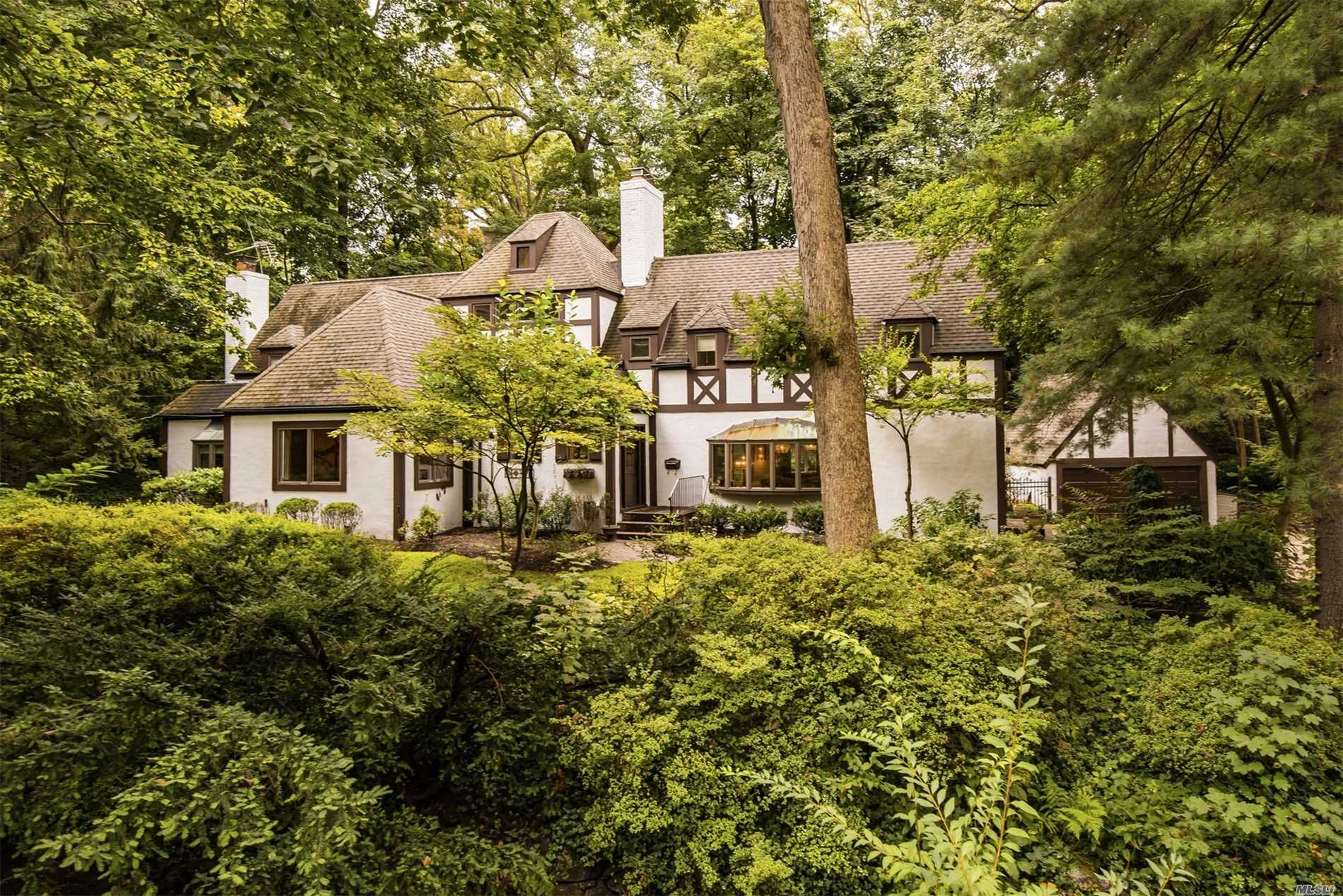 Beautifully Renovated French Normandy Tudor W/3 Brs 2.5 Bths On A Brook In Baxter Estates. This Pristine Home Offers Charm Galore Boasting A Stepdown Lr W/Fp & French Doors To Garden. Magnificent Fdr Overlooks Lush, Landscaped 1/3-Acre. Custom Built-Ins, Fpl & Beamed Ceiling In Great Room & Custom Eik W/Marble Counters, And Radiant Heated Floors. Mbr Suite W/Sitting Area & Master Bath W/Radiant Heated Floors, 2 Brs Full Bth. 2-Car Garage. Near Town & Lirr.