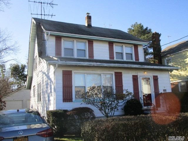Updated Legal Two Family With Both Units Vacant. Walk To Lirr And Shopping. New Carpeting, Garage Doors And Appliances.