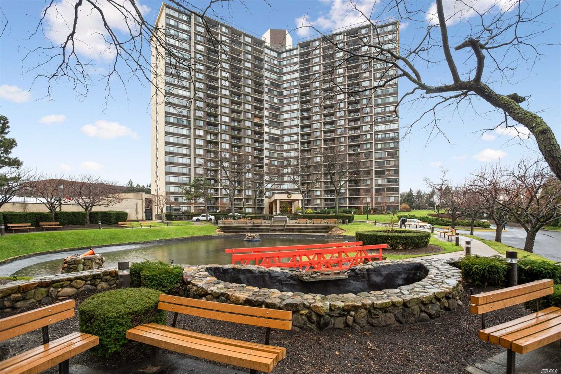 Fully Renovated Large 1 Bedroom Apartment With Breath Taking City And Water Views.  This Must See Apartment Is Located In The Luxuries Bay Club Gated Community, 24 Hour Security Staff, Doorman & Concierge Service, Fitness Center & Pool. Near Shopping Center, Transportation (Express Bus To Nyc) & 5 Minutes By Auto To L.I R.R. Special Features Includes Custom Remote Control Blinds, Hard Wood Floors, Custom Doors, Walk In Closets, New Energy Efficient Appliances, Granite Counter Top & Much More.
