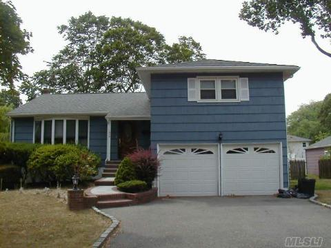 Spacious 3Br 3Bth Split In Wantagh Woods Sd23, Lr W/New Bay Window, Dr W/Sliders To Deck W/Oversized Property, Ext Eik W/Granite Counters And Ct Floor, Mbr W/Fbth, Den W/New Ct Bth, Finbsmt W/Walk-In-Closet, Updates Include Roof, 2Yr Hw Heater, Wash/Dry, Windows, 200Amp Elec., Cac, 2Car Gar. Taxes Do Not Reflect Star Of $1080.28