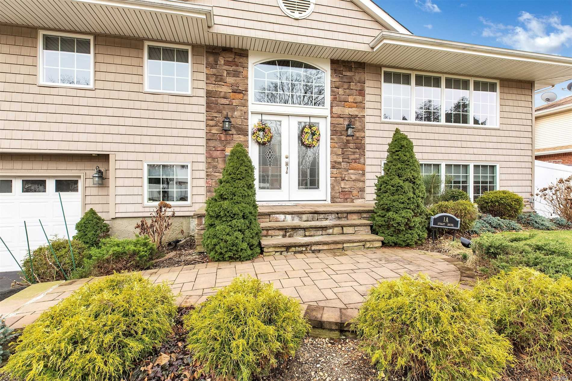 Syosset. Beautifully Maintained High Ranch With Many Upgrades. Updated Kitchen Has Open Flow To Dining Room. Spacious Master Bedroom Boasts Oversized Ensuite Bathroom And Closets Galore. Family Room With Fireplace Is Sure To Please. Backyard Is Perfect For Entertaining With A Beautiful Salt Water Pool. Don't Miss Out!