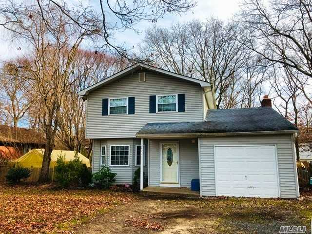 Great 3 Bedroom Colonial With Hard Wood Floors Throughout. Master Bedroom Suite On 1st Floor.