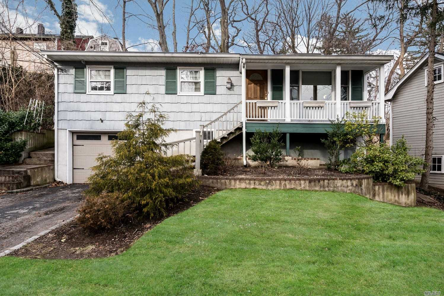 Charming Hillside Ranch, 4 Bedroom 2.5 Bath With A Fully Finished Lower Level At Street Level. Hard Wood Floors Throughout Bedrooms And Living Space. Central To Village, Library, Shopping And Lirr. Town Beaches, Boating, And Parks Nearby. Award Winning Locust Valley Schools.
