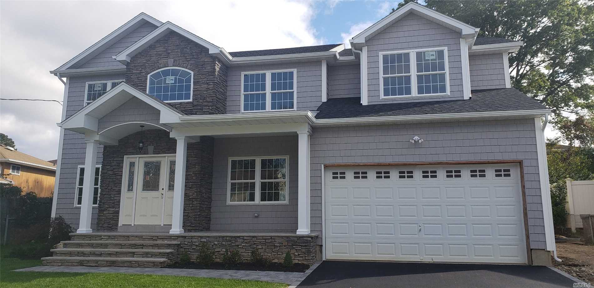 Priced To Sell Stunning New Construction, 5 Br's, 3 Baths, 2 Car Gar, Front Porch, Cac, Igs, Gourmet Eik, Grand Entry Foyer, Flr, Fdr, Bedroom/Office On 1st Flr, Laundry On 2nd Floor, Oversized Master Ensuite, Dual Wics, Hw Floors, Full Basement 8' Ceilings, Energy Star Rated!! Village Elementary, Close To Rr, Shopping Near Oyster Bay Beaches!~ Interior Photos Shown Are Not An Exact Model Of The House