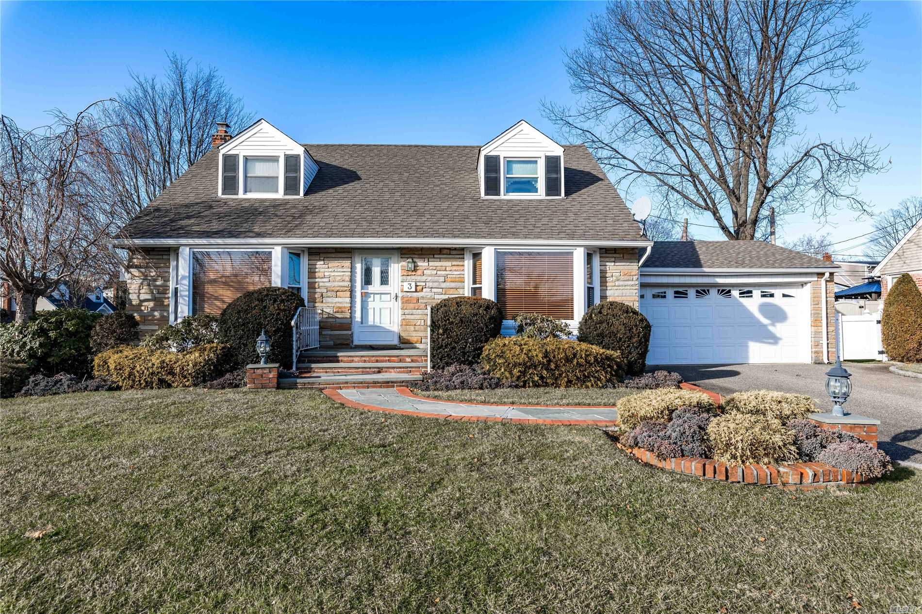 Lovely Expanded Cape In Carle Place Schools,  Features 5/6 Bedrooms, Eat-In-Kitchen, Formal Dining Rm, Living Rm, 2 Full Bath, Hardwood Floors Under Carpeting, Possible Mother Daughter W/Proper Permits,  Full Basement W/ Utility Rm,  2 Car Garage, Back Up House Generator, Inground Sprinklers, Close To All Major Highways !! A Must See