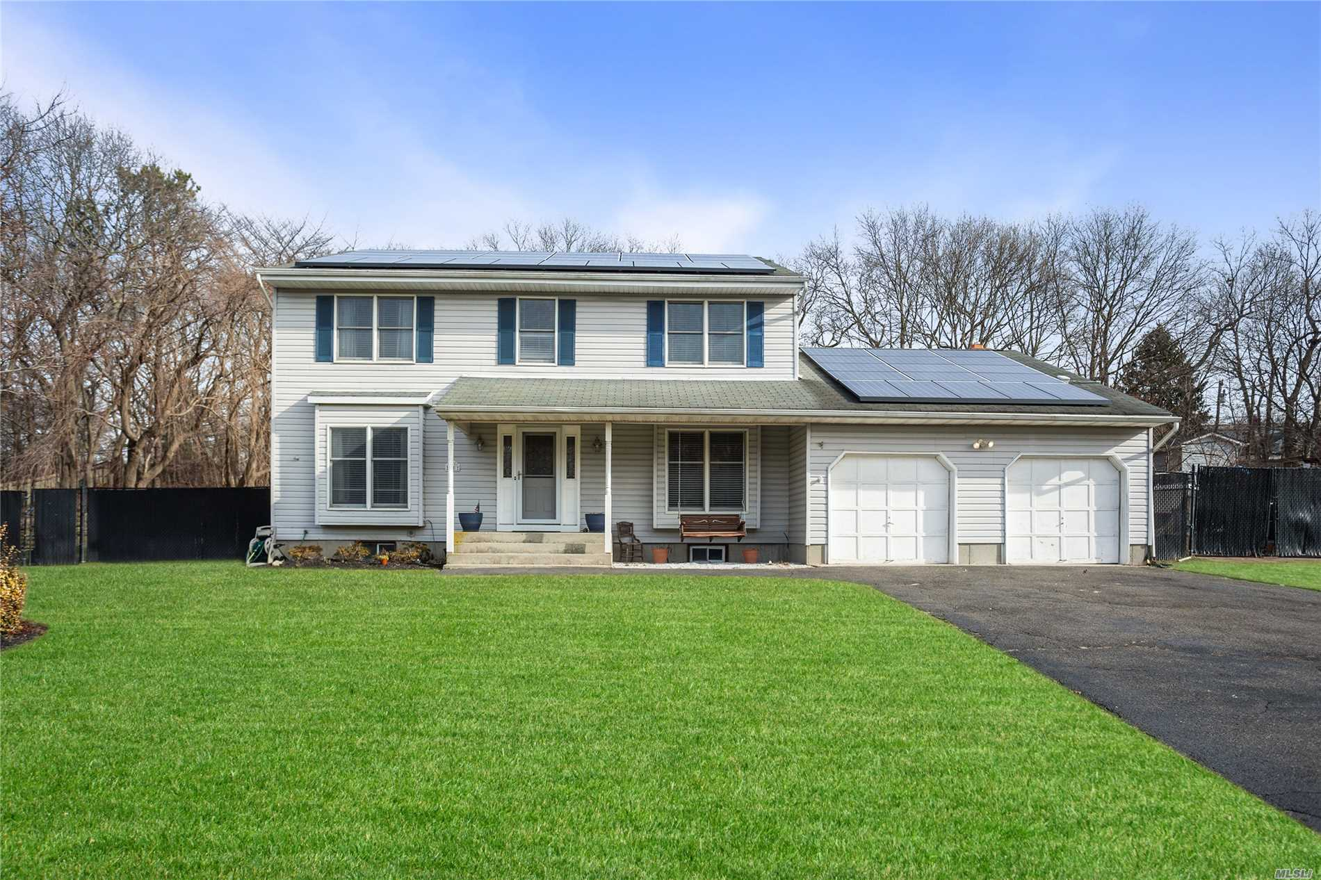 This Beautiful Sprawling 4 Bedroom 3 Bath Home In Sachem Schools Features Full Basement, Attic, Solar Panels, 2 Car Garage, And Family Room With Fireplace. New Kitchen And Baths, Multiple Skylights For Plenty Of Natural Light. Master Suite With Master Bath. Located On A Quiet Secluded Block.