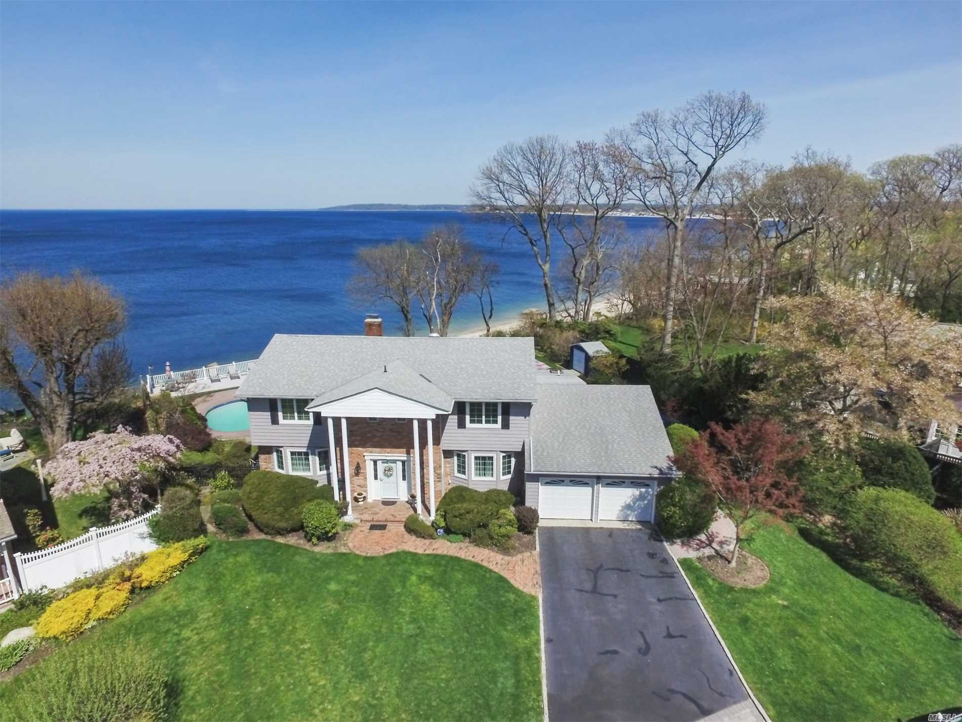 Picturesque Waterfront Colonial Nestled On A High Bluff With Breathtaking Views Of The Long Island Sound. This Home Boasts 5 Bedrooms, Large Expanded Kitchen With Window-Lined Views Of The Sound, Heated Gunite Pool, Large Maintenance Free Deck With Private Steps Leading Down To The Beach And Much More. Wake Up To Glistening Water Views While Watching Gorgeous Sunsets In The Evening. Fantastic Opportunity To Live On One Of The Few, Truly Waterfront Homes Remaining!