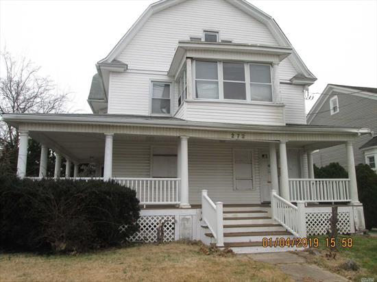 One Of The Largest Home In The Village. This Legal 2 Family Has Plenty Of Potential. With Just Over 4300 Square Feet Of Living Space This Home Can Be Everything You've Ever Wanted. Bring Back This Homes Original Beauty And Classic Look. 2 Family permit expired with Village. New owner can reapply.