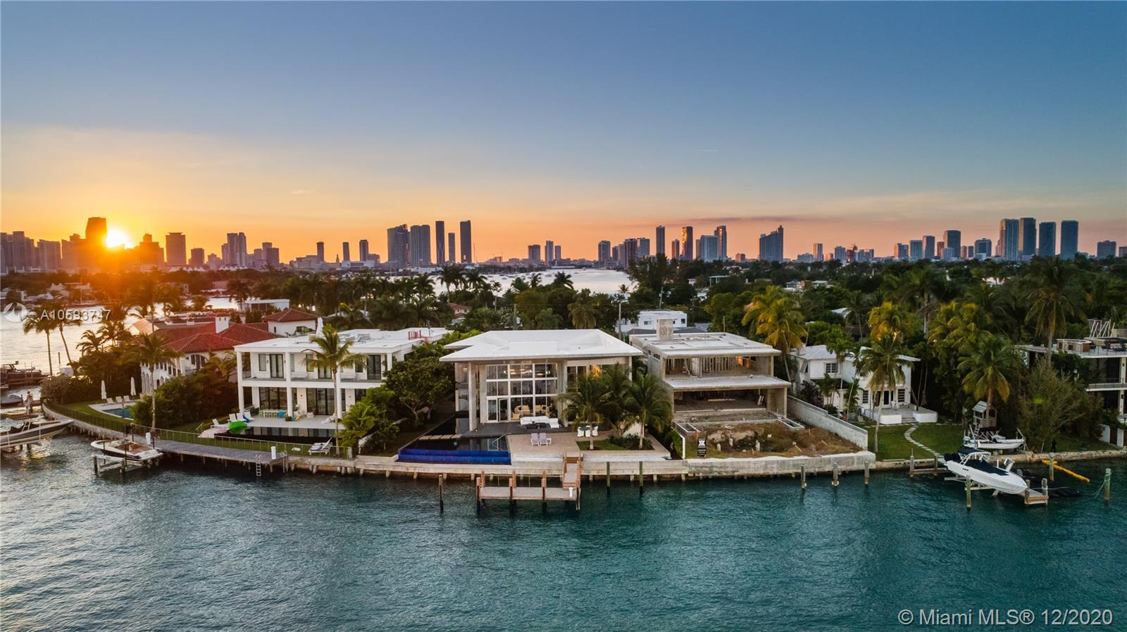 Architectural Modern Masterpiece And One-Of-A-Kind Work Of Art On Coveted Venetian Islands! The Art Connoisseur, Interior Design Lover, And Future Owner Will Revel In This Fully Custom Awe Inspiring Home. Boasting Expansive Biscayne Bay Waterfront Views, Soaring Ceilings Mixed W/Cantilevered Concrete & Voluminous Glass, Floating Sculpture Staircase W/Illuminated Black Quartz, Unique 19+Ógé¼Gäó Noa Rated Entry Door Never Again Replicated And Interior Tropical Garden W/Sustained Irrigation System. Chef Inspired Enormous Tailor Made Snaidero Kitchen & Bar W/Temp Controlled Glass Wine Room Is An Entertainers Dream! In Addition, Each Of The 5 Bedrooms Have En Suite Baths & Fully Built Out Custom Closets, 2 Separate Family Rooms W/Incredible Views, Commercial Grade Elevator, And 3 Car Collectors Garage