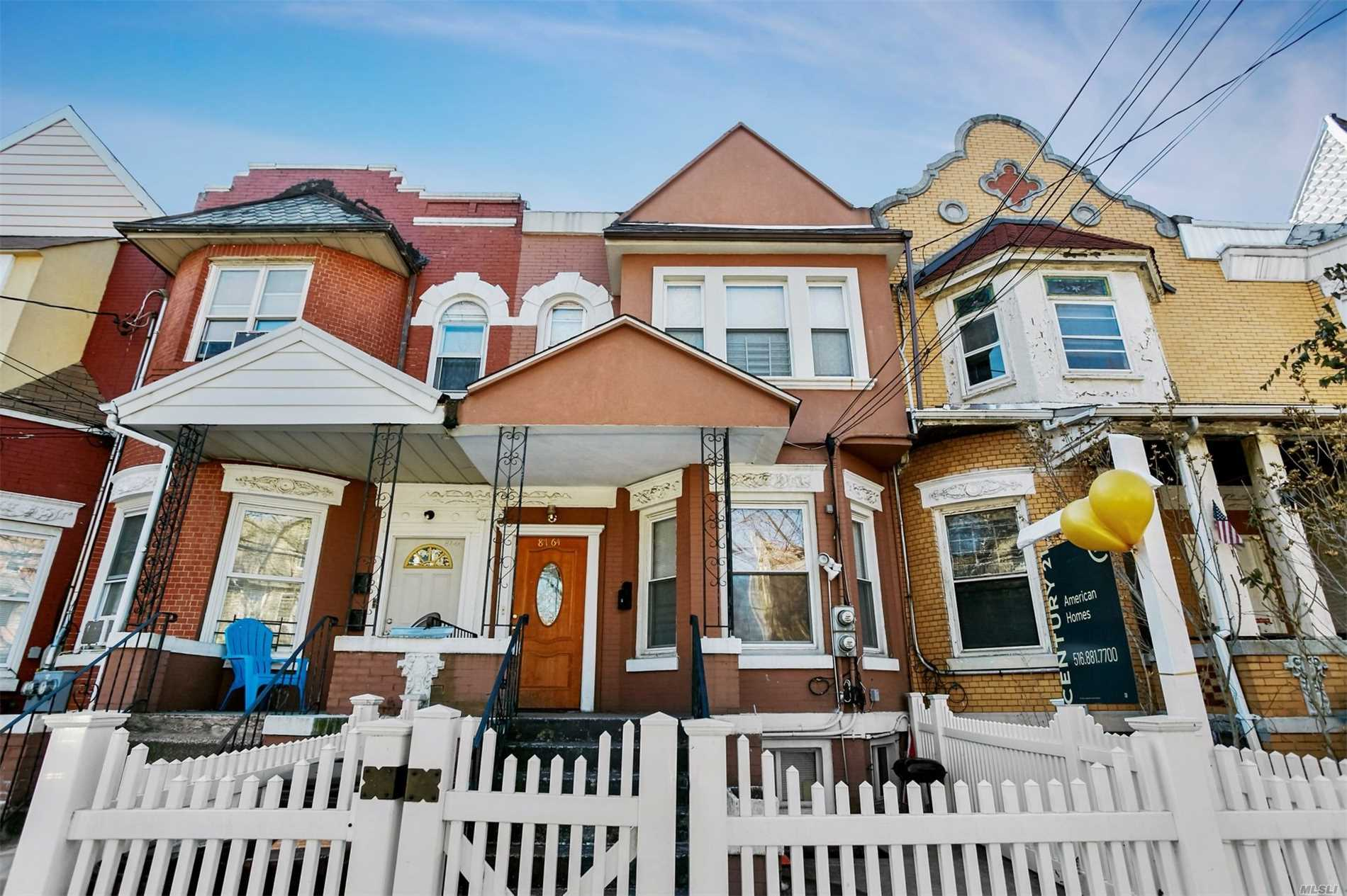 Beautiful Brick Two Family House One Over Two Beds In The Heart Of Richmond Hill.  Features 2/Kitchens 3/Full Baths, Full Finished Basement With Separate Entrance For All. Two Gas And Electric Meters.