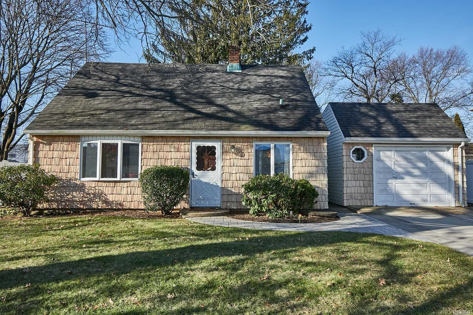 Rear Dormered Expanded Cape In The Flower Section Boasts 5 Bedrooms (1 Currently Being Used As Dr), Large Living Room, 2 Full Baths & Office/Nursery. Sitting On A Picturesque Oversized Lot. 1.5 Car Detached Garage & 4 Car Driveway.