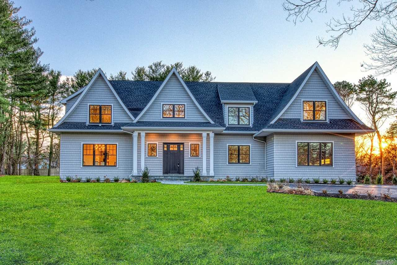 Introducing Dix Hills Finest New Construction Build! This Hamptons Inspired Shingle-Style Home With Sweeping Gables Has 10' Ceilings, Black Andersen Windows, 5 Beds/4.5 Baths Including En Suite Guest Bedroom On 1st Floor. Exquisite Design Starts In The 2-Story Foyer & Continues Throughout W/Custom Kitchen, Quartzmaster Counters, Bertazzoni Appliances. Extensive Trim Package, 4.5 Designer Baths, 2 Fireplaces W/ One In Master Suite, $100K+ In Upgrades Including Professional Landscaping/Patio & More