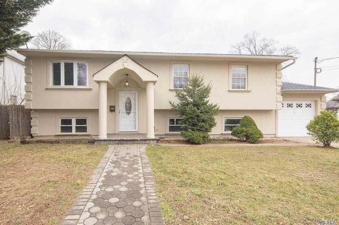 Beautiful Rare Updated High Ranch In Freeport, 3 Spacious Bedrooms On Upper Level, Full Bath, Living Room With Dining Space And Beautiful New Kitchen, New Appliances, Lower Level - Separate Entrance Has 2 Bedrooms (Or You Can Use As A Den/Family Room) New Washer& Dryer