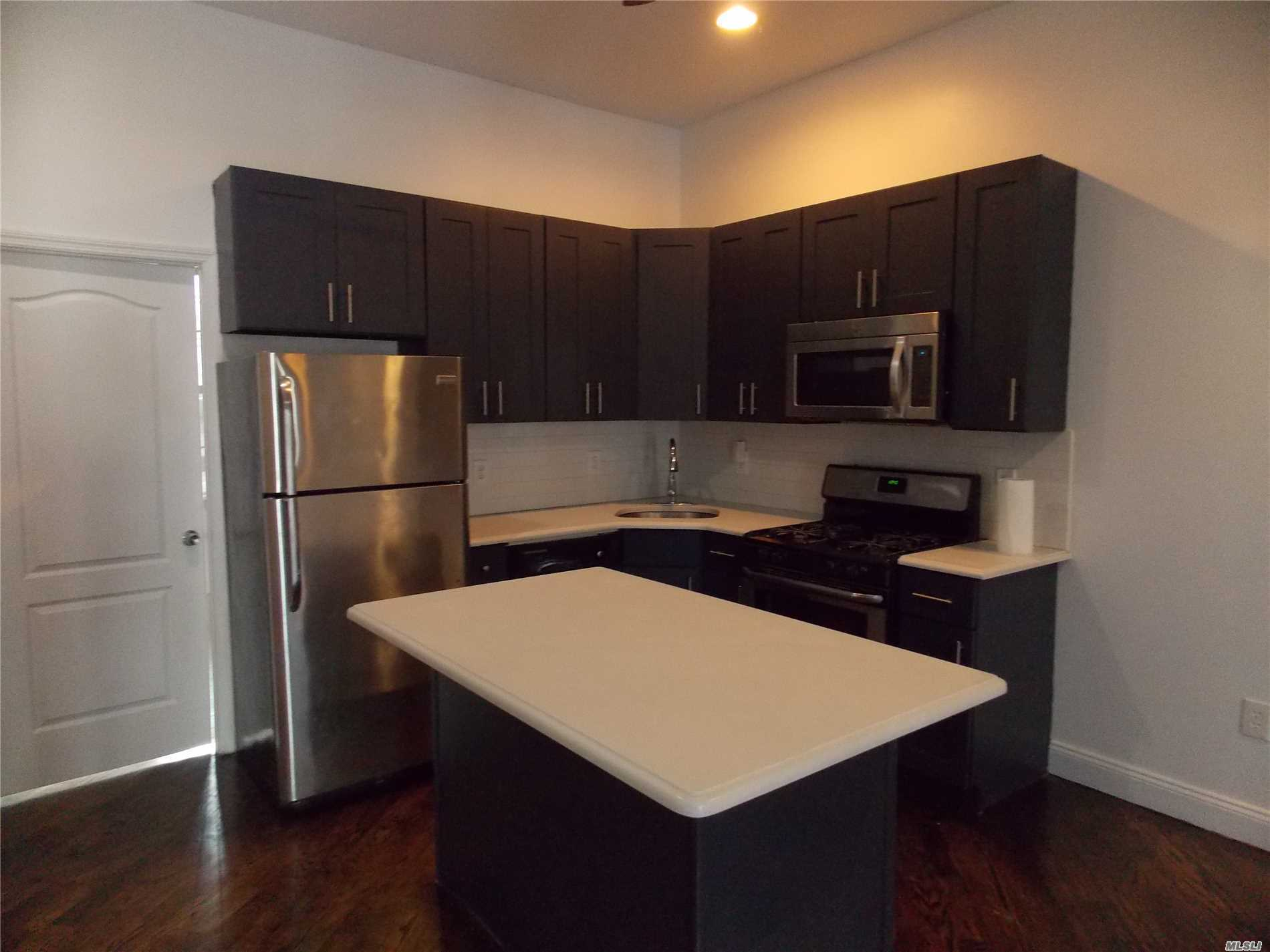 Renovated 2 Levels, 4 Bedrooms, 3 Full Baths. Close To Subway, Restaurants And Shops.