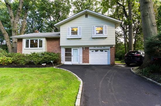 Magnificent Opportunity To Live In Glen Head And Enjoy The Roslyn School District! Lovely, Recently Renovated Home Features Bright And Open Kitchen With Granite Countertops, Stainless Steel Appliances, And Gleaming Hardwood Floors. Kitchen Opens To Beautiful Sunroom Overlooking Meticulously Landscaped Backyard. Only Minutes From Greenvale Lirr Station.