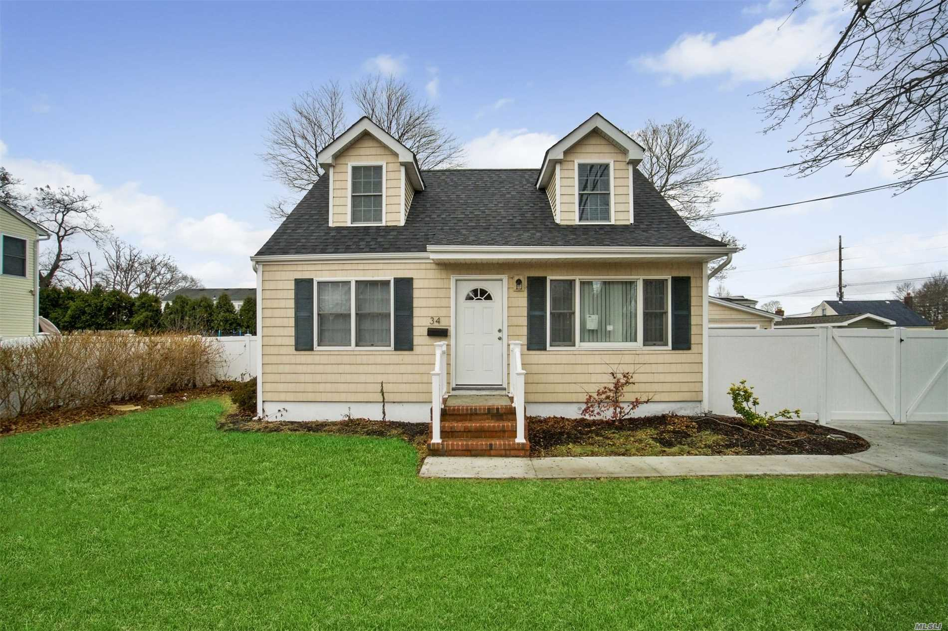Move Right Into This Charming Cape Freshly Updated W/ New Carpets, Wood Floors, Updated Kitchen & More! Ss Appliances & A Ton Of Storage In The Basement & Huge 2 Car Garage! Set Your Lawn Chair Out On The Rear Deck & Enjoy Suffolk County Living! Come & See This Gem For Yourself!