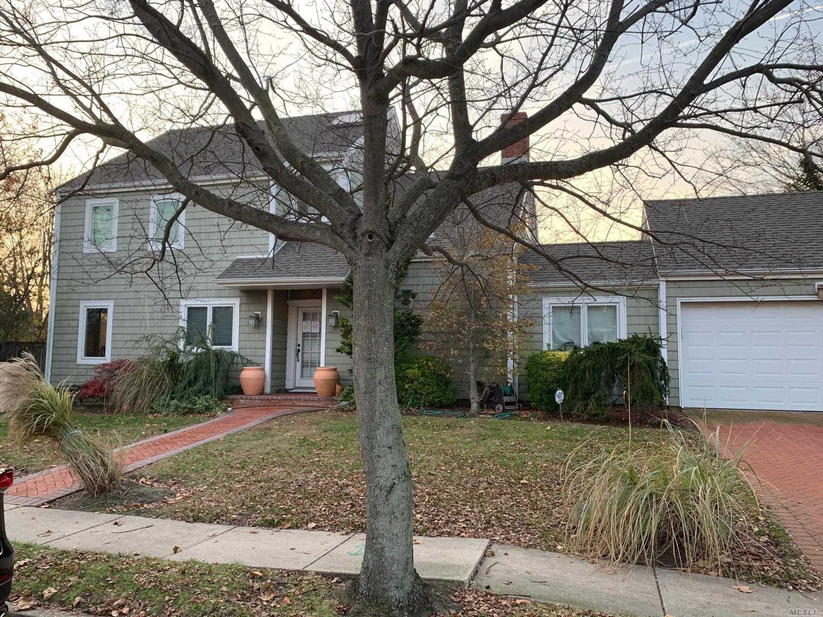 Detached Single Family Colonial With Private Driveway And Attached One Car Garage Located In Hempstead Township. Property Features Partial Attic, Three Bedrooms, Two Full Bathrooms, And One Half Bathroom.
