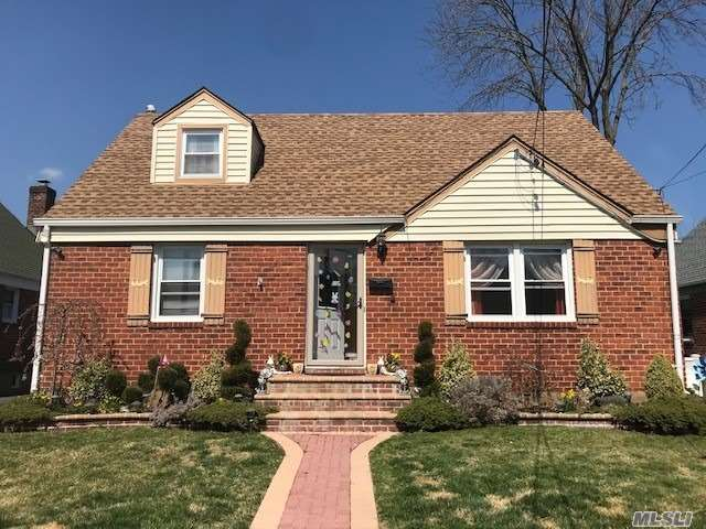 Beautiful Brick Cape, Quiet Dead End Block, Many Updates Since 2008. Sitting On 5000 Sqft Lot, 3 Brs, Lg. Living Rm,  Formal Dining Room W/Sky Lights, Custom Built Kitchen Cabinets & Granite Counter Tops, Stainless Steel Appliances, Ceramic Tile Floors, Recessed lights, Ceiling Fans,  Hardwood Floors on 1st Fl., Full & Finished Basement With Bath & Brand New Roof & Gas Boiler, Central Air Condition, Det. Garage, 4 car drive ways, Fenced in Back Yard for Perfect Entertainment!