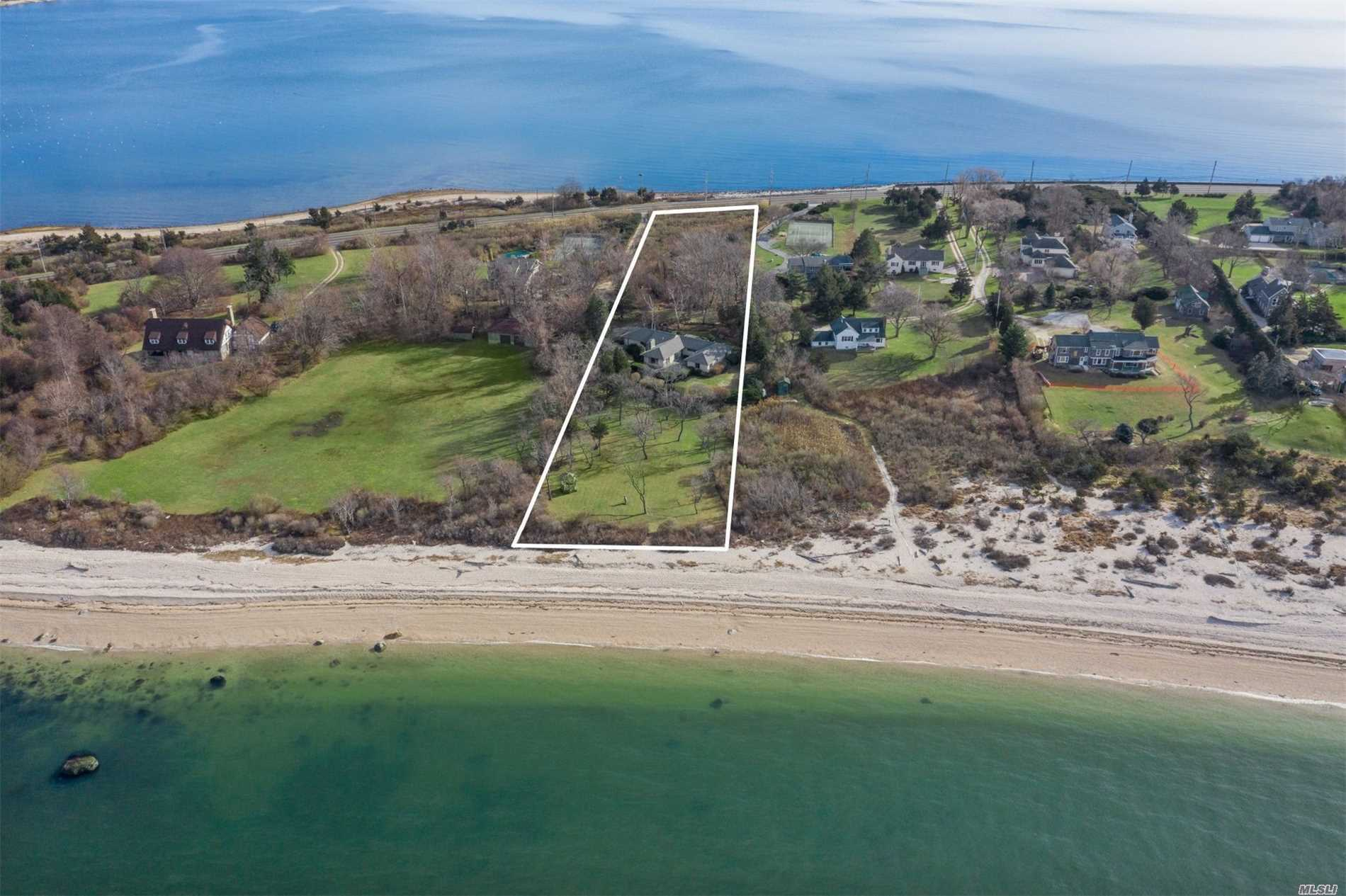 Rare 3+ Acres That Run From Orient Bay To The Sound. 3 Bed, 3.5 Bath Ranch On Stunning Property. 148' Of No-Bluff Private Sound Beach. Living Room W/Stone Fireplace, All Bedrooms Ensuite, Waterfront Stone Patio, And Sprawling Lawn To Sound. Room For Pool.