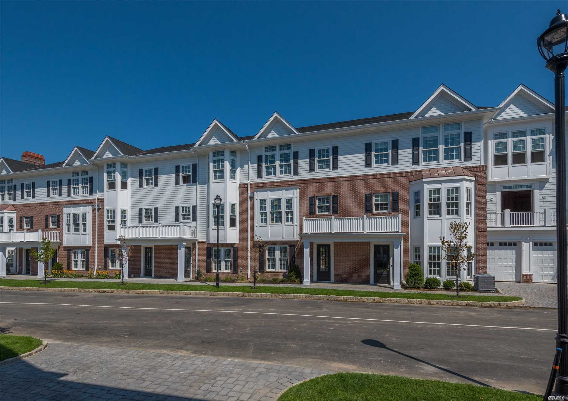 Luxury New Townhouses In The Heart Of Roslyn Village. Elegant 2750+Sqft 3 Bed, 3 Bath Condo Featuring Top Of The Line Kitchen And Baths, Gas Fireplace, Private Elevator, 2 Car Garage. Set On 12 Acres W Waterside Promenade, Kayaks, Bbq Area, Playground And Private Clubhouse. True Urban-Suburban Living. One Block To Town, Shopping, Theater, Library And Restaurants.