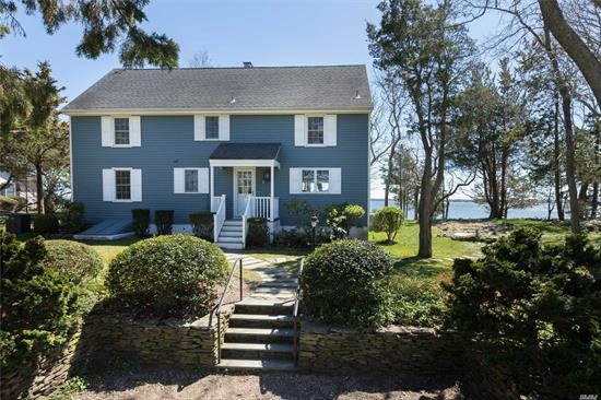 Quiet, Peaceful And Serene Setting Down A Private Road Off Peconic Bay Blvd., This Property Offers Over 100' Of Sandy Beach On The Bay, 4 Bedrooms And 2 Baths, A Wood Burning Fireplace In The Living Room, Generous-Sized Kitchen And Hardwood Floors Throughout. New Washer/Dryer And Refrigerator. Move Right In And Experience Waterfront Living On The North Fork At Its Best.