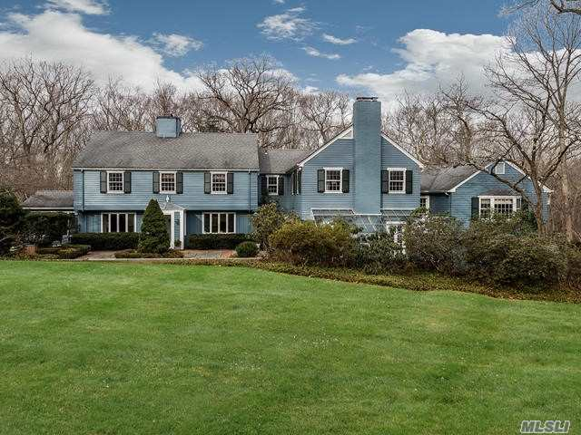 Taxes Are Being Grieved! Successfully getting Tax Reduction. Private Retreat. Traditional Colonial Set On 2 Very Private Acres Surrounded By Conservation Preserve & Planting Fields Arboretum. Step Down To An Elegant Living Room With Wood Burning Fpl & Wet Bar. FDR, Updated Eik W/Seating Area Surrounded By Windows Overlooking Yard. Wood Paneled & Beamed Ceiling Library W/ Fpl., Sun Room Perfect All Seasons. Lower Level Den, Fbth With Walk Out To Pool&Patio. Close To LIRR, Shopping & Beach.