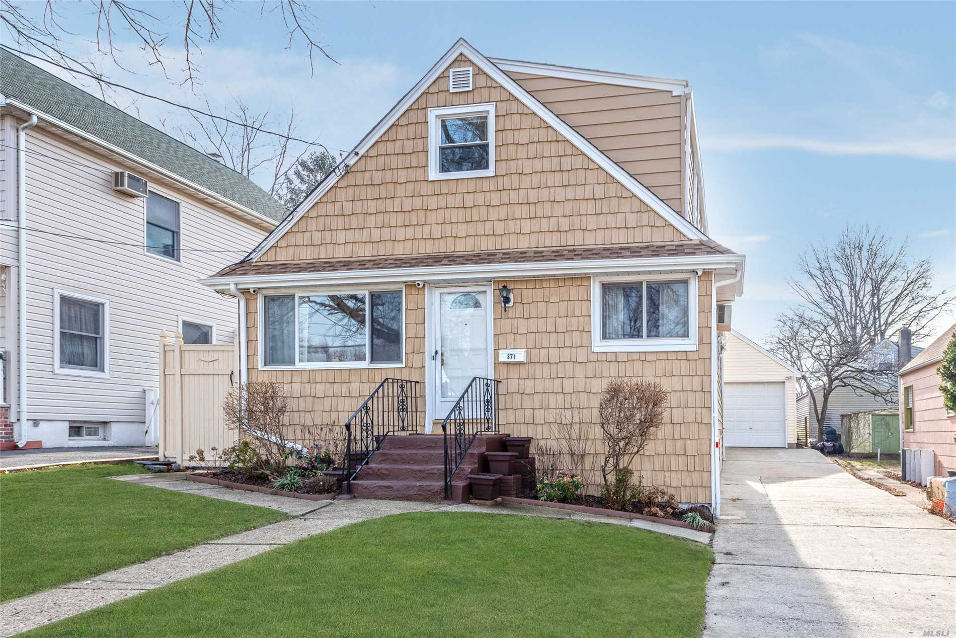 W. Hempstead 4 Bedroom 2 Bath Updated Cape. Kit, Dining Area, Living Room Full Finished Basement With Outside Entrance To The Yard. Hardwood Floors Throughout. Gas Hot Water Heater And With Oil Heat. 1.5 Car Garage With A Long Driveway. Close To Shops.